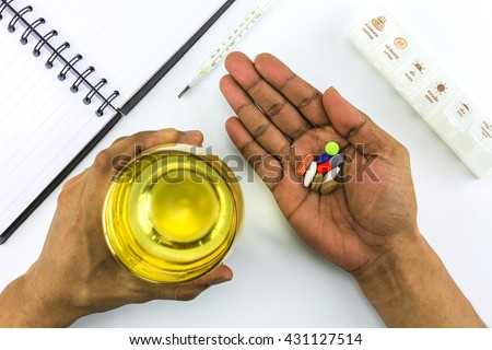 Groups of medicines for patients with a congenital disease on white background. - stock photo