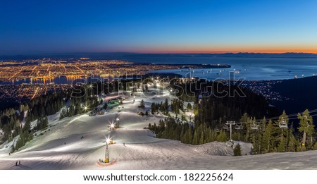 Grouse Mountain ski resort with a beautiful view of Vancouver city, British Columbia, at dusk - stock photo