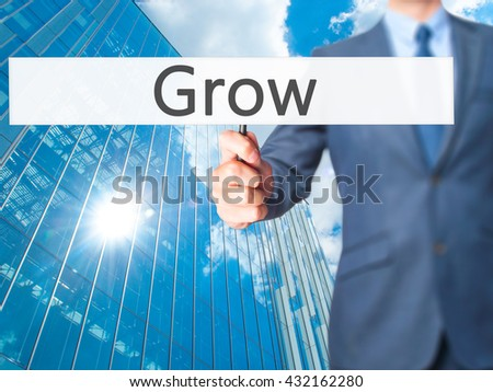 Grow - Businessman hand holding sign. Business, technology, internet concept. Stock Photo
