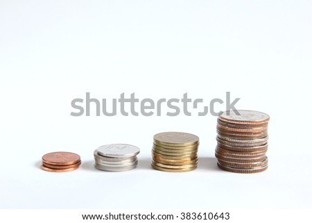 Grow up of stacking coin on white background