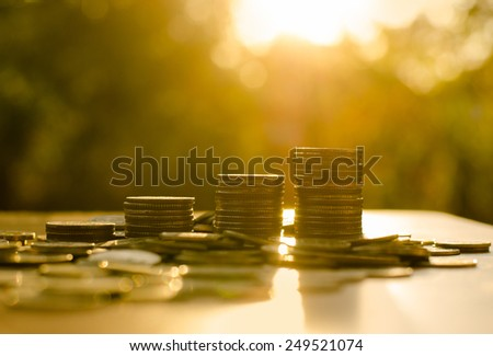 growing money coins stack  with sunset, Saving concept - stock photo