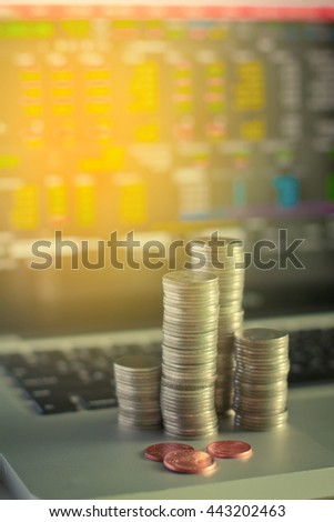 Growing money concept with laptop financial background,vintage color,selective focus