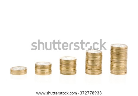 Growing one euro coin stack isolated on white background. Growing savings symbol