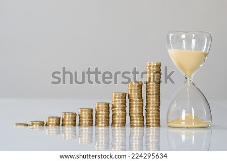 Growth chart and hourglass. Isolated on white - stock photo