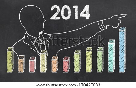 Growth in 2014 with Creative Businessman showing Positive Graph