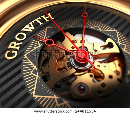 Growth on Black-Golden Watch Face with Closeup View of Watch Mechanism.  - stock photo