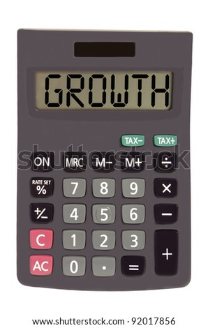growth on display of an old calculator on white background