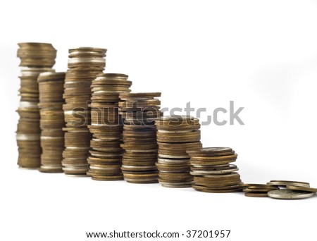 Growth or economic crisis - towers assembled of coins shallow DOF with focus on the right side - stock photo