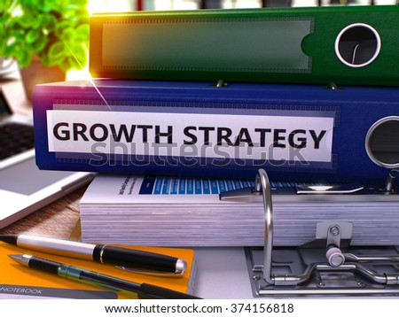 Growth Strategy - Blue Ring Binder on Office Desktop with Office Supplies and Modern Laptop. Growth Strategy Business Concept on Blurred Background. Growth Strategy - Toned Illustration. 3D Render. - stock photo