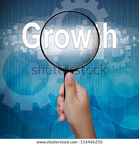 Growth, word in Magnifying glass; business background - stock photo