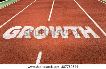 Growth written on running track