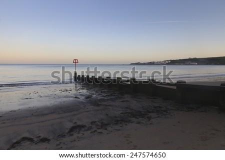 Groyne on Swanage beach in the evening - stock photo
