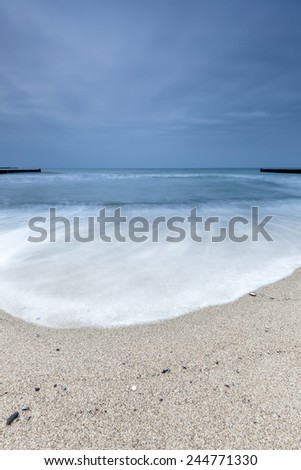Groyne on the baltic sea coast - stock photo