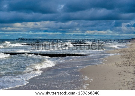 Groynes in the surf on the German Baltic coast