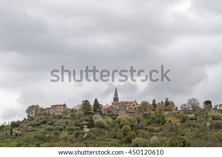 Groznjan - idyllic mountain village on a hill high above the the Mirna Valley - stock photo