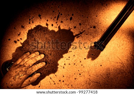 Gruesome forensic crime scene of a violent murder or suicide death with dead man hand in a splatter of blood next to a gun weapon on floor during a police criminal investigation in rough grunge sepia - stock photo