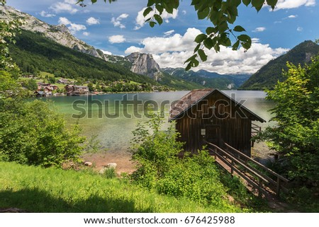 Grundlsee, idyllic landscape with lake and mountains in summer.Romantic vacation in Austria