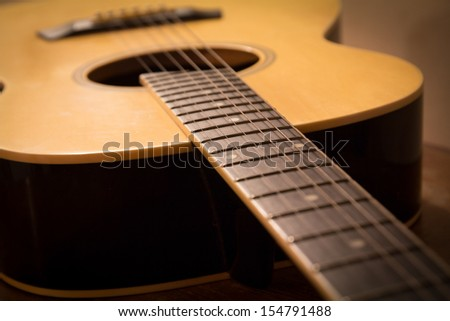 grunge acoustic guitar on wood table