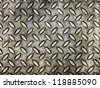grunge and dirty iron floor plate with diamond motives. - stock photo