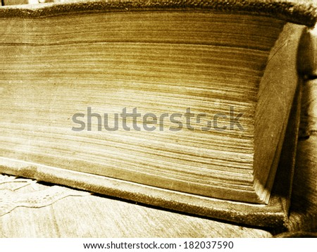 Grunge background closeup of old book pages, retro photo effect. - stock photo