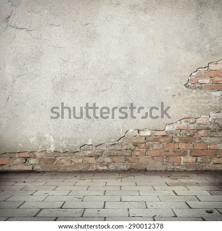 grunge background, damaged brick wall texture bright plaster wall and blocks road sidewalk abandoned exterior urban background for your own concept or project - stock photo