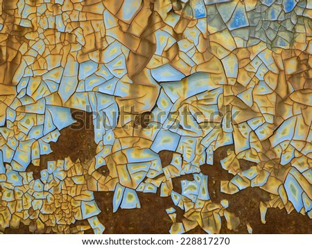 Grunge background of rust and corrosion with peeling blue paint. - stock photo