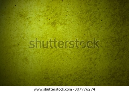 Grunge background of yellow concrete wall with scratches - stock photo