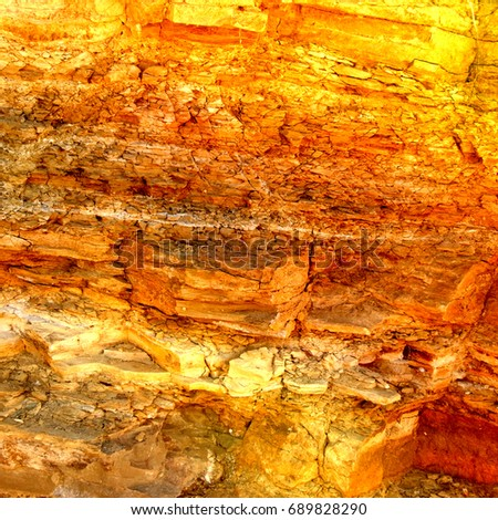 Grunge background texture gold yellow textured stone wall mine rock Wallpaper