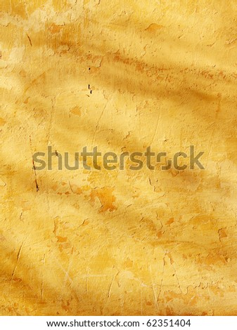 Grunge background - texture stucco of ochre color - stock photo