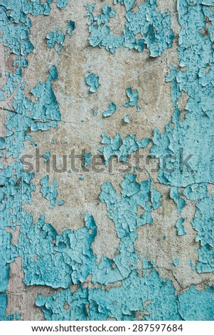 Grunge Background. Wall with the colored blue whitewash falling off fragment as a background texture - stock photo
