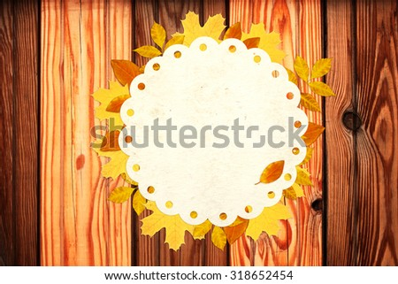 Grunge background with autumn leaves and old wood texture - stock photo