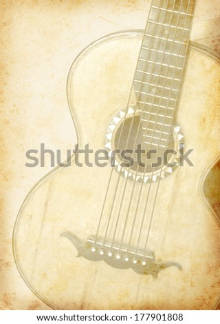 Grunge background with guitar for music design. Old guitar on vintage paper texture. - stock photo
