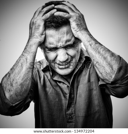 Grunge black and white  image of an angry man in pain - stock photo