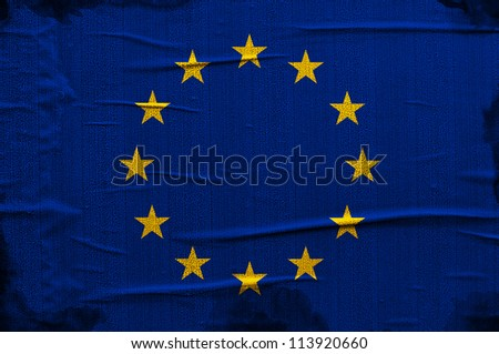 Grunge blue European Union flag with yellow stars overlaying a grungy texture