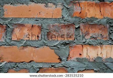 Grunge brick wall background. Brick texture closeup - stock photo