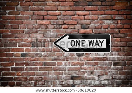 Grunge Brick Wall with Black and White One Way Sign - stock photo