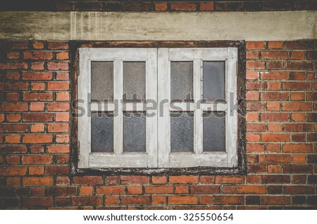 grunge brickwall and wooden frame window , vintage styled - stock photo