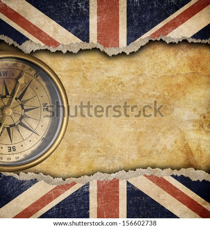 Grunge British flag and old brass compass - stock photo