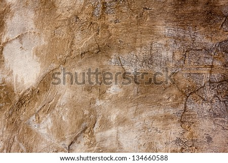 Grunge brown background -- humid concrete wall with cracks, smudges and stains. - stock photo
