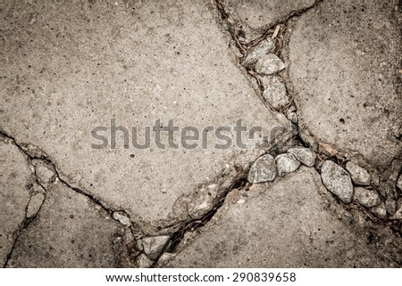grunge cement cracked with rock for textured background