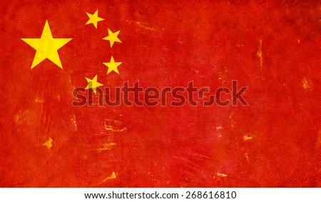 Grunge Chinese flag on rough edged wall background - stock photo