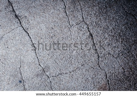 Grunge concrete cement floor with crack.