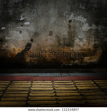 grunge concrete wall with tile floor.