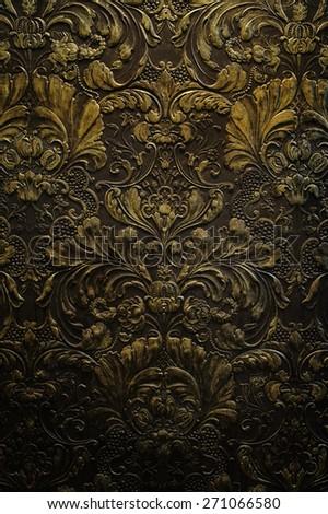 grunge dark gold wall ornament texture background - stock photo