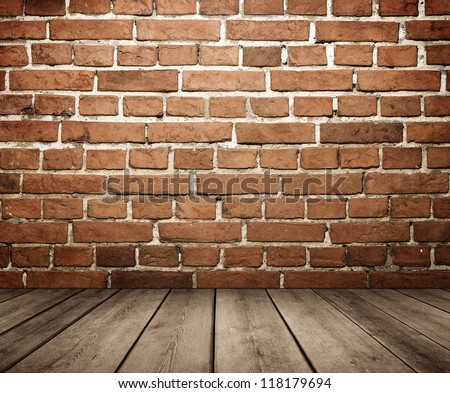 Grunge empty interior with brick wall and wooden floor with copy space - stock photo