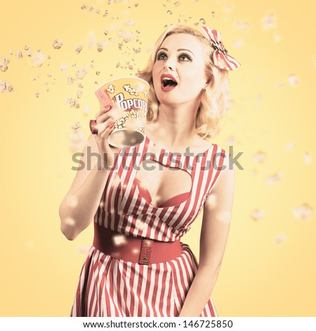 Grunge film portrait of a beautiful cinema woman watching big screen with flying popcorn.  Retro films concept - stock photo