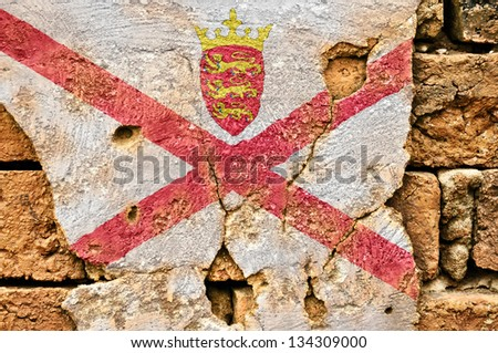 Grunge flag of Jersey on old wall background. - stock photo