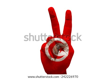 grunge flag painted hand making the V sign isolated over white background - stock photo