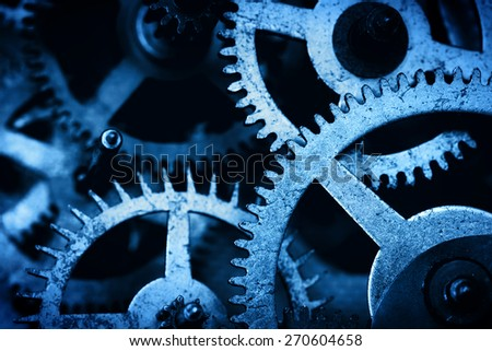 Grunge gear, cog wheels background. Concept of industrial, science, clockwork, technology. Blue tint. - stock photo