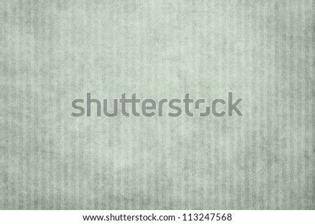 Grunge green striped paper texture with copy space - stock photo